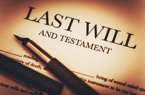 A last will and testament doc lays on a table with a pen. The more thought you put into your will, the less likely it could be contested.